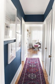Blue hallway paint, dark blue hallway, hallway wall colors, hallway r Blue Hallway Paint, Dark Blue Hallway, Hallway Wall Colors, Hallway Walls, Striped Hallway, Entry Hallway, Modern Hallway, Long Hallway, Wall Colours