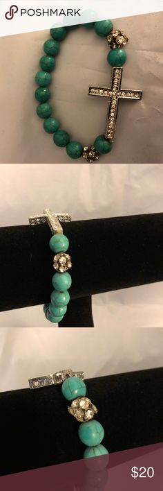 """Sterling Silver Sideways Cross Bracelet with Pave NWOT Sterling Silver Cross Charm with CZ's and cut out hearts all around, cross measures 2"""" long This bracelet comes with two 10mm Pave CZ Crystal beads. Rest of bracelet is made of 10mm turquoise beads Strung on an expandable elastic cord Fits 7.0"""" - 7.5"""" wrist. STRETCHES SANDY'S BEAD CREATIONS Jewelry Bracelets"""