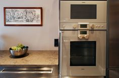 Stainless Steel kitchen with limestone top and 17th century engraving from www.mybluechina.com