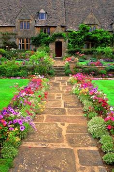 Chipping Mansion ~ Stone pathway bordered by flower beds