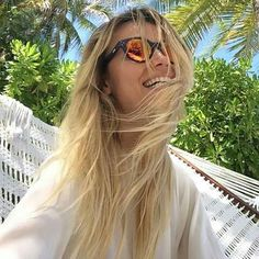 afc989a1317 Natasha Poly sharing a huge and mesmerizing smile whit her Vitesse Blue w  Orange mirrored lens by Spektre Sunglasses