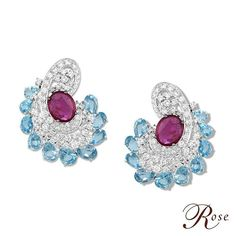 A flawless pair of earrings from our 'Colours of Life' collection is crafted with Ruby Ovals and Blue Topaz amidst Brilliant-Cut Diamond, set in 18k White Gold from The House of Rose.