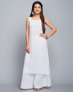 Must have whites. Never go wrong with this white chikankari Kurta. Made using cotton cambric fabric, this kurta comes with a boat neck. Pair up with our range of silver earrings and bags and you are ready to go!  Cotton Cambric Chikankari Embroidery Boat Neck Sleeveless Hand Wash Separately in Cold Water