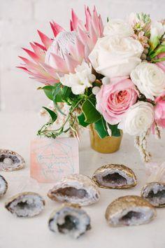 Pink protea floral centerpieces.