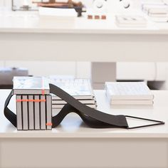 "BOOK AND MAGAZINE SUPPORT: ""TRIANGOLO SI"" / Anima Grigia - This versatile and unique hanging book shelf, named ""triangolo sì"" (the yes triangle), does double duty as a practical storage solution for books and magazines while adding a distinct and modern design element to any room. It comes in two sizes, at 50 cm (20"") and 100 cm (40"")."