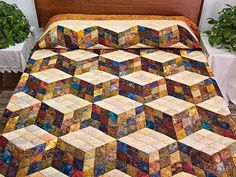 Tumbling Blocks Quilt. Lovely hand painted Batik style fabrics give the classic…
