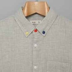 Or if you feel like using needle and thread instead of a hot glue gun, swap the buttons out on a dress shirt.