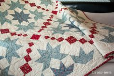 "Modern quilt, traditional blocks. I think these are ""snow crystals,"" but I'd have to check around to be sure."
