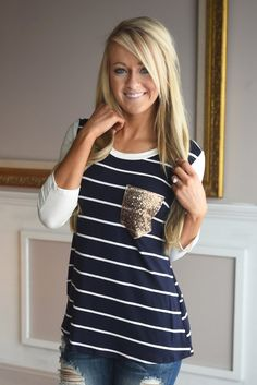 This adorable top features a sequin pocket against navy and white stripes.  True to size. Top does have stretch to...