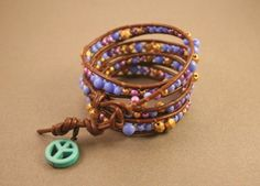 Brown Leather Wrap Bracelet with Multicolor Beads (Blue, Gold, Purple) and Teal Peace Sign Charm.