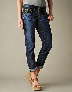 Clean, streamlined boyfriend jeans are a must.