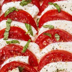 Tarragon Caprese Salad - 2 ounces sliced fresh mozzarella with 2 sliced beefsteak tomatoes and 2 tablespoons chopped fresh tarragon: 246 calories