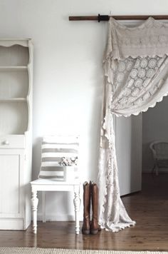 Just adore this crochet curtain. Borrowing this idea for the shop!