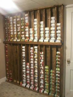 Want to shop those canned food sales but can't store them easily? Build a canned food dispenser on a pantry wall for easy storage. always be able to see what you have before you buy more. Omg I love how organized this is! Canned Food Storage, Pantry Storage, Kitchen Storage, Basement Storage, Garage Storage, Bedroom Storage, Can Storage, Diy Bedroom, Smart Storage