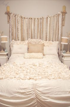 Our Guest Bedroom Makeover: Ribbon Headboard (Burlap, Lace, and tulle) attached with pink glass doorknobs (Hobby Lobby), Burlap lamps (Hobby Lobby - added rosettes to lamp shade), pedestal (Hobby Lobby), Ivory Lucia bedding