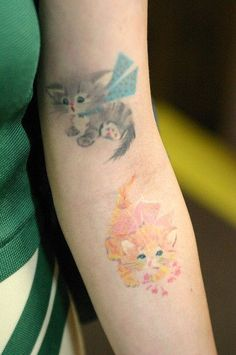 Adorable watercolor tattoo on arm for girls
