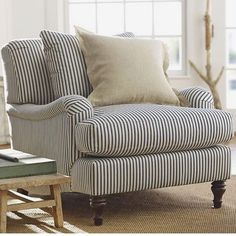 Blue and white striped Pottery Barn armchair. Country style decor. Hamptons style home.