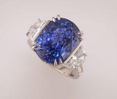 Stunning cushion cut sapphire flanked by half-moon diamonds.