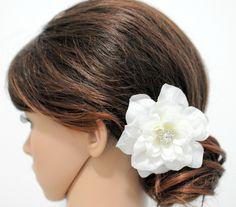 White/Light Ivory Wedding Hair Flowers Bridal hair piece Ivory flower hair. $16.75, via Etsy.