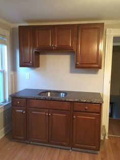 After Renovation  Kitchen  new cabinets, flooring, ceiling fan, granite counters, paint and flooring