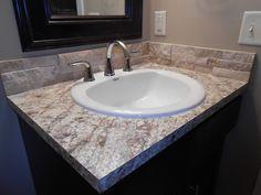Vencil Homes - Bathroom #5 - Laminate vanity top in the basement bath with stone backsplash.