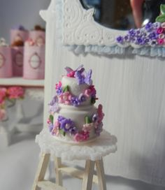 Dollhouse Miniature - 2 - Tier Vanilla Frosted Cake Garnished with Flowers and Butterflies - 1/12th Scale. $35.95, via Etsy.