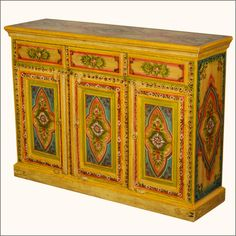 Bring the warmth and vibrancy of a sun garden into your home all year round with our intricately hand painted #buffet with Indian inspired designs. This hand made three door cabinet opens onto a large 2-shelf cupboard. There are also three convenient top drawers. The ornate decorative floral paintings enhance the front, sides and top of the #cabinet. #interiors #contemporaryfurniture #homedecor #furniture #homeinspiration   http://www.sierralivingconcepts.com/