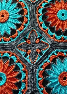 Crochet Daisy Afghan by Joleen Kraft on Ravelry. I love the color choice.