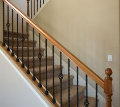 More wood-topped black metal balusters + carpet