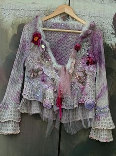 RESERVED for E. --Whimsy vintage lacy cardi/jacket, altered couture; reworked with intricate details to discover. The hems are draped with antique embroidered net- cotton tambour lace, and accentuated with vintage silver metallic embroidered details, hand stitches with wool, glasspearls.