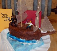 one of my first cakes.....a pirate theme chocolate cake for big  lil boys!  the birthday boys were 7  53 yrs young----pirates are cool at any age!  ;) cakes-by-mii food-that-means-something