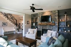 hgtv fixer upper--love the wood floors here and the stone on the fireplace (style)