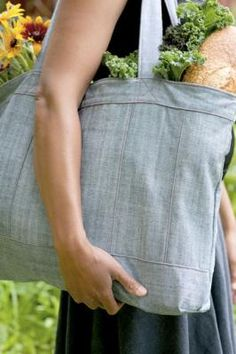 Transform a pair (or two) of jeans into a simple but refined carry-all with this easy sewing project for a recycled denim handbag.