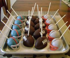 superbowl-46-pops - Super Bowl XLVI cake pops, giants and patriots helmets = vanilla cake/vanilla ABC/white bark, footballs = german choc cake/vanilla ABC/choc bark, candy clay adornments