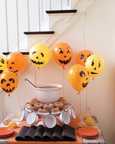 Pumpkin Balloons    Bring a gaggle of helium-filled jack-o'-lantern balloons to life near the refreshment table in no time. Draw simple features onto inflated balloons with permanent marker. Choose an assortment of geometric shapes that are easy to create freehand.