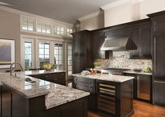 Traditional Kitchen with U-shaped, Flat panel cabinets, Complex granite counters, Flush, Crown molding, Complex Granite