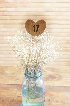 cute, easy mason jar centerpiece with baby's breath + table number holder | via http://emmalinebride.com/decor/easy-table-number-idea/