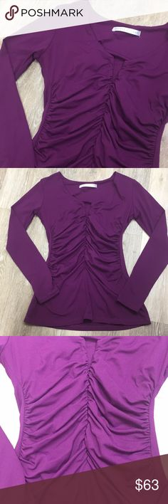 Women's Susan Monaco gathered long sleeve top Women's Purple Gathered Top. Zipper zips down pretty far in the front. Never worn. Excellent condition. Size Medium.   💋Please ask any questions you may have BEFORE purchase.💋  ❤️ Bundle together with other items for the cutest outfit, and best deal!! ❤️  😍 I am ALWAYS open to offers, please just submit your offer with the offer button!!! 😍  🎀As always HAPPY POSHING. 🎀 Susan Monaco Tops Tees - Long Sleeve