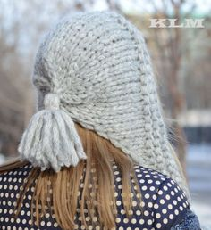 Gray hood hat made from soft bulky yarn. Hood style hat with long tassels. Ponytail tassels on each side. Can be wrapped around or hanging.  Perfect for autumn and winter.    The composition of the yarn: 30% wool, 10% mohair, 35% acrylic, 25% nylon.    Hand wash, dry flat.    I ship orders worldwide via registered airmail (with tracking).