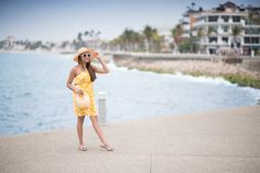 In today's fashion / travel blog post we visit Puerto Vallarta 's Malecon (boardwalk). I am featuring this fun yellow floral dress from Old Navy along with a straw hat, Neutral Wicker / Rattan Beach Bag, Kate Spade sunglasses, and Jessica Simpson flats. Visit my site http://colorsofmei.com/yellow-florals-puerto-vallarta-malecon/ for affordable outfit ideas for your mexico or beach getaway!