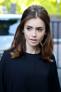 Lily Collins Hasnt Met a Beauty Look She Hasnt Tried . or Nailed: She had a slight vibe to her beauty look while in the UK. Light pink lipstick, a voluminous blowout, and a flick of eyeliner were Lily's cornerstones. Top Hairstyles, My Hairstyle, Pretty Hairstyles, Wedding Hairstyles, Celebrity Hairstyles, Hairstyle Ideas, Middle Part Hairstyles, Stylish Hairstyles, Makeup Hairstyle