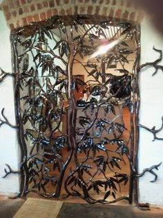 """The York Mill Gallery features this beautiful set of gates called the """"Marri Tree of Life""""."""