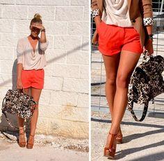 "So effortlessly ""cool""...drapey beige top, orange shorts, AWESOME leopard bag, and heels!"