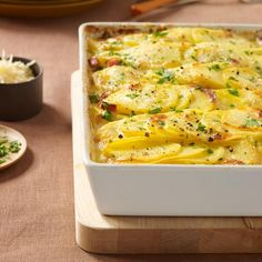 Scalloped Potatoes with Ham | The combination of pecorino and Parmesan gives these potatoes a great cheesy depth.