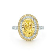 Tiffany & Co. Fancy Vivid Yellow diamond ring in platinum and 18k gold with white diamonds.