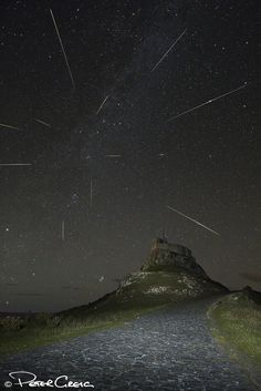 Astrophotos A composite of stacked images of the Perseid Meteor Shower on August 2013 seen from Lindisfarne (Holy Island) off the northeast coast of England. Credit and copyright: Peter Greig. Sistema Solar, Night Sky Photos, Perseid Meteor Shower, Today Images, Space And Astronomy, Astronomy Science, Science Nature, Science Space, Astronomy