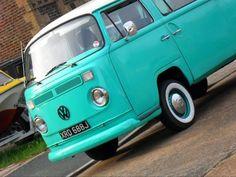 Turquoise mini-bus.