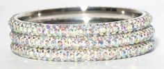 Bangle: 3 Rows of Swarovski Crystal Elements - AB -Sold Individually - please read the description Sophistikitty, http://www.amazon.com/dp/B007ZFLXFE/ref=cm_sw_r_pi_dp_G.Vkqb1QN9W1E
