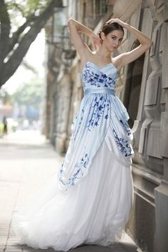 I really like the whole jewel tone on white for a wedding dress, it gives personality and color without being a solid block or satin on white satin...