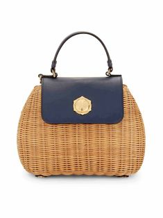 In handwoven natural straw with leather trim, our Overlook Bag is a summer favorite. Finished with our signature magnolia hardware and ticking stripe lining, it's a beautiful piece you'll carry for years to come.